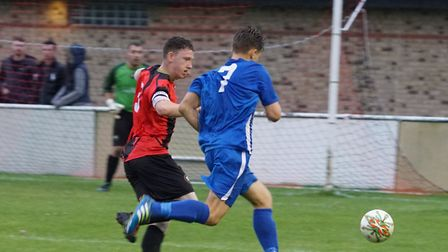 Huntingdon Town captain James Seymour defends against Josh Smith of Pinchbeck. Picture: @RUSSELLDOSS