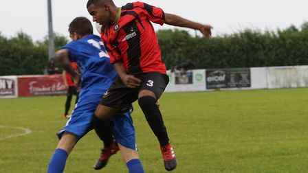 Huntingdon Town defender Ruben Rey gets off the ground against Pinchbeck. Picture: @RUSSELLDOSSETT w