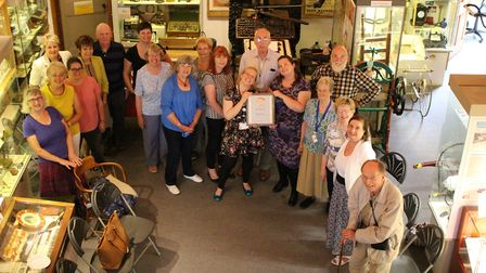 Royston's museum assistant Amy Judd and curator Jenny Oxley holding their certificate with guests at