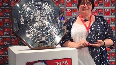 Wendy Chambers receieves her award at Wembley.