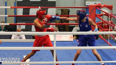Shona Whitwell, in blue, in action against Sweden's Agnes Alexiusson.