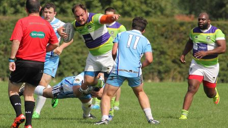 Scott Clewlow punches a hole in the Crusaders defence. Picture: DARRYL BROWN