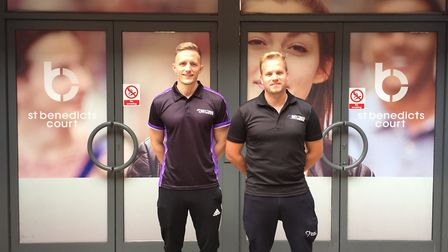 Anytime Fitness staff James Ducket, sales manager, with Drew Davis in front of the unit that will be