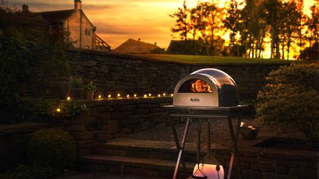 Portable pizza oven with waterproof shell, part of a new range by Delivita. Wood-fired and suitable