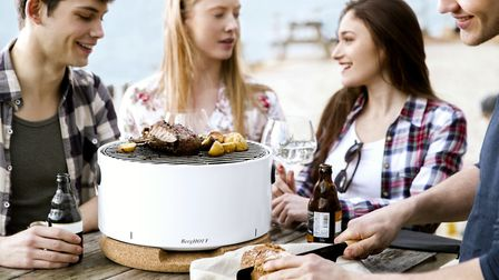 Table barbecue from the German manufacturer Berghoff sits on a cork board which soaks up the heat an