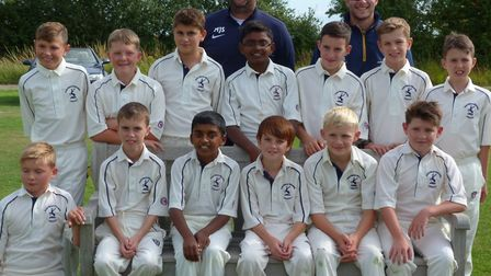 Pictured with coaches Matthew Slack and Dan Robinson, the Hunts Under 11 squad are middle row, left