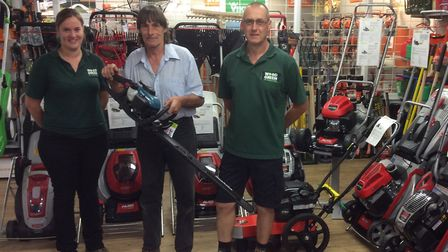 Shepreth's Wrights Mower Centre staff donated a trimmer to the team at Wood Green, The Animals Chari