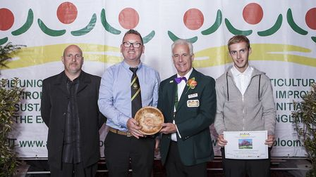 The Huntingdon Town Council team collects its In Bloom award.