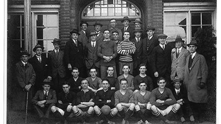 Minter in the front row with the Hatfield Road Old Boys team, with a ball between his legs - a pose