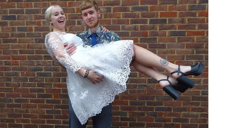 Volunteers modelling a wedding dress from Scope in St Albans