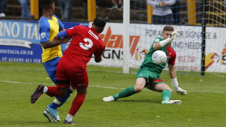 Kieran Monlouis looks on as Bailey Vose blocks his shot. Picture: LEIGH PAGE