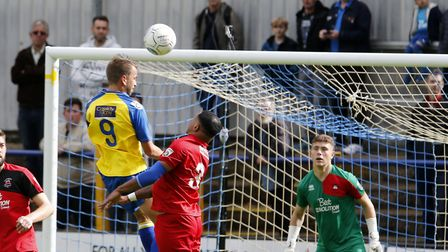 Sam Merson is unable to direct his header on goal. Picture: LEIGH PAGE