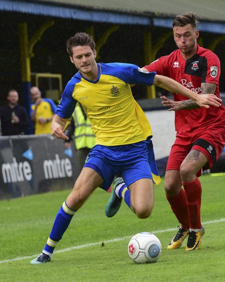 Tom Gardiner battles to keep the ball for St Albans City. Picture: BOB WALKLEY