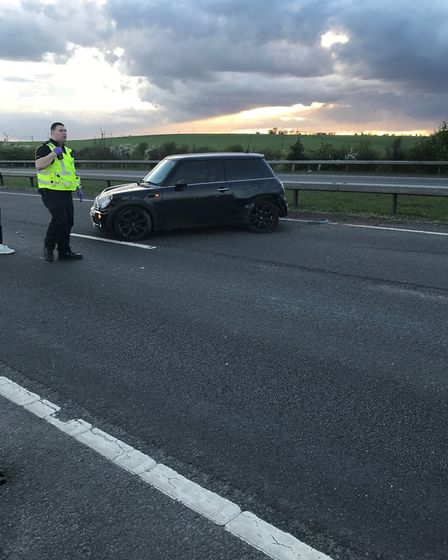 A car driving the wrong way on April 1 caused a mini to crash into the central reservation of the A5