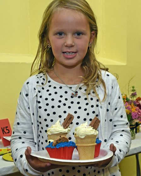 Lilly Shaw with her cakes.