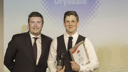 David Croft with the winner of the Service to the Community Award Callum Drysdale.