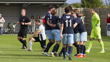 Celebration time for St Neots Town during their 5-0 demolition of Dorchester. Picture: CLAIRE HOWES