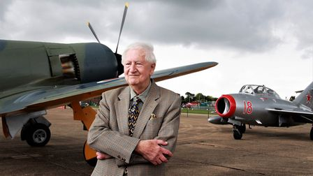 Brian Ellis with a Hawker Sea Fury Aircraft and a Mig-15 fighter in the background. Picture: Clive P