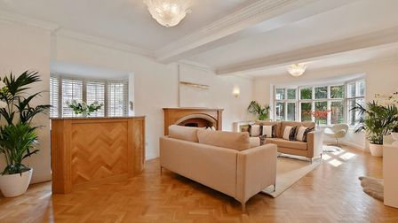 Many original features remain, such as beautiful parquet flooring