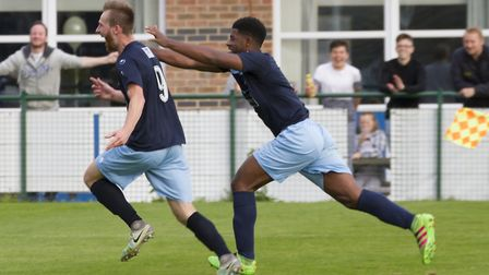 Tom Meechan (left) sets off in celebration after putting St Neots Town ahead against Slough. Picture