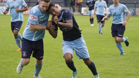 St Neots Town goalscorer Dion Sembie-Ferris battles with a Slough defender. Picture: CLAIRE HOWES