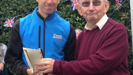 Michael Taylor of Riverside Runners receives his trophy after the Swineshead 10-mile race.