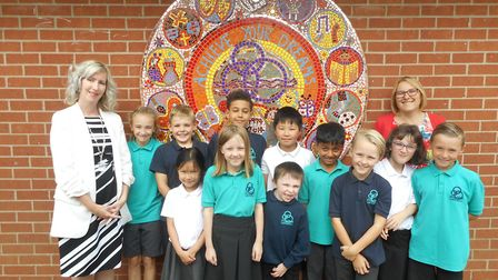 Headteacher Anne Eardley and SENCO Sarah Clee along with some Crosshall pupils.
