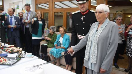 Former Grove House patient and current volunteer Margaret Fensome officially cut the cake with Rober