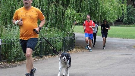Scott Clarke, seen with his dog JJ at the Luton Wardown Parkrun, will compete at his 100th different