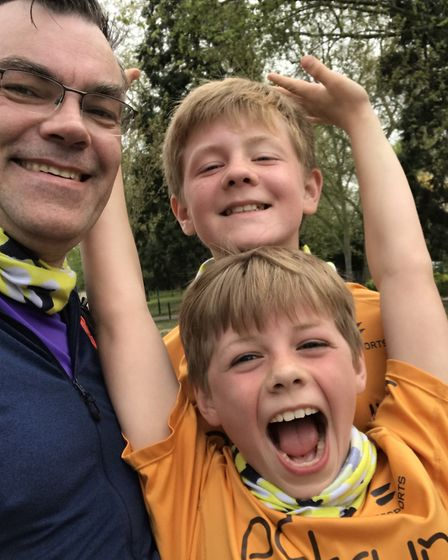 Scott Clarke, seen with sons Joseph and Samuel, will compete at his 100th different parkrun venue at