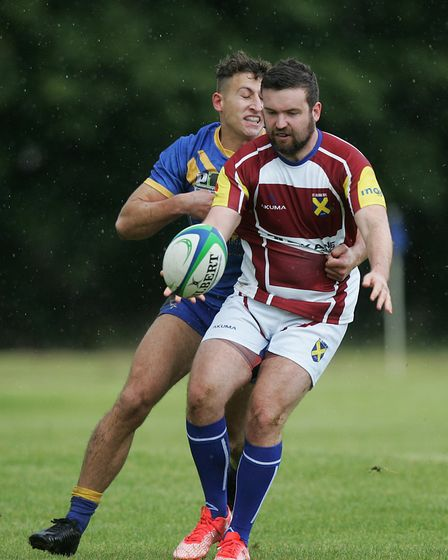Christopher Jones tries to clear under pressure from Alex Ricci. Picture: KARYN HADDON
