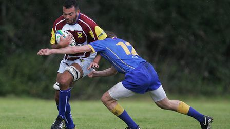 Jordan Cox is tackled by Tom Bloomfield for Verulamians. Picture: KARYN HADDON