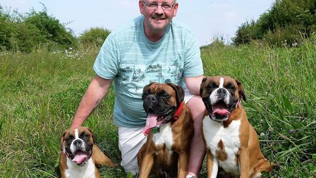Mitchell Bailey with his dogs.