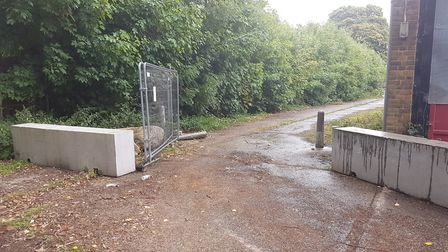 The left-hand gate to the rear of the Heathlands Drive fire station site, where travellers allegedly