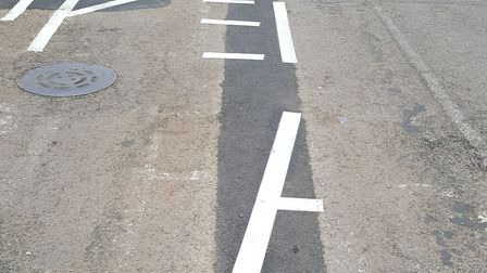 The road markings are only half completed.