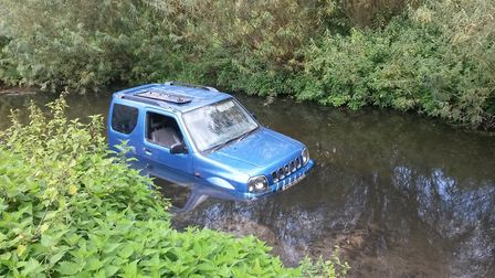Car trapped in Batford Springs. Photo: HARPENDEN TOWN COUNCIL