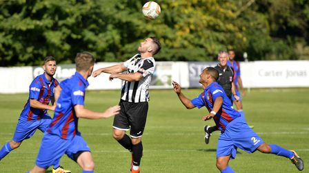 St Ives Town striker James Hall uses his head during their FA Cup success against Coalville Town. Pi