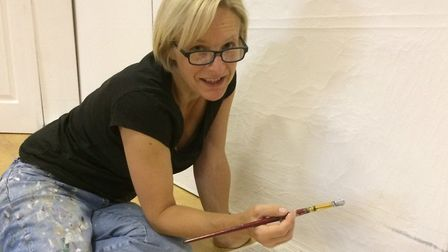 Emma Shaw painting the set for Pygmalion. Picture: CADS