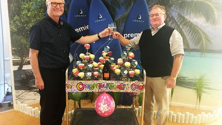 Peter Andrews (left) toasts his 50-year partnership with chairman and fellow co-owner Renford Sargen