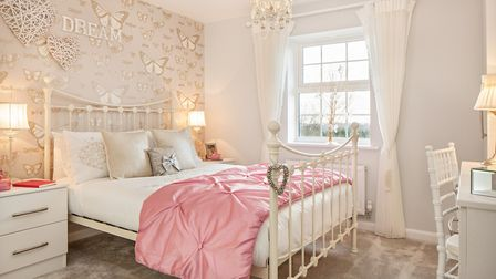The pretty bedroom in the Ware show home