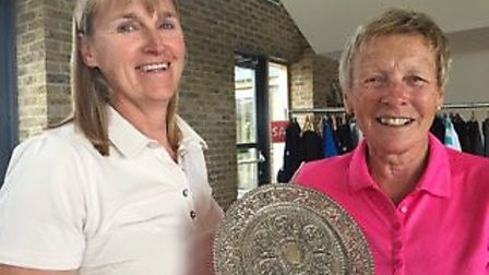 Lady Captain Trish Whittamore presents the Grannies' Trophy to Angela Boon at St Ives (Hunts) Golf C