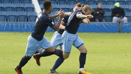 St Neots Town captain Luke Knight sets off in celebration after opening the scoring at Farnborough.