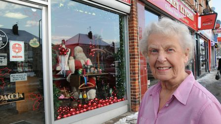 Christine Campbell Owner of Fashion 'N' Fabrics. Shop front dressed for One show.