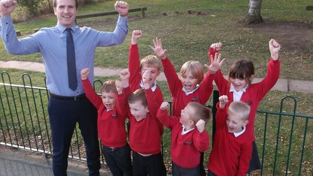 Acting head teacher Mark Farrell with some of the pupils