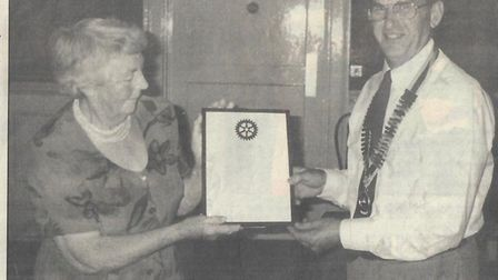 Betty Skyrme receiving a Community Service Award from David Bannister, as reported in the Crow in Se