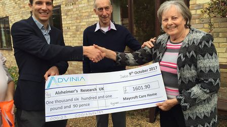 Gerald Brackley and Carol Bradshaw handing over the cheque to Steve Andrews. Picture: Lynn Ward