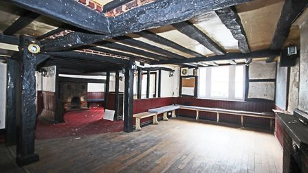 There are two former bar areas with windows to the front and open fireplaces