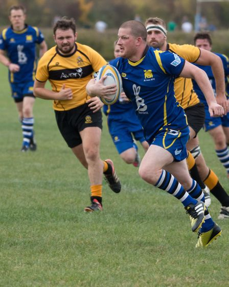 St Ives man Mickey Drake on the run against Northampton Casuals. Picture: PAUL COX