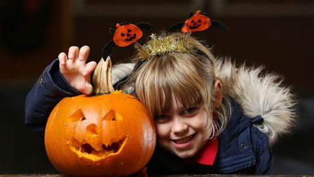 Anwen with her Halloween pumpkin at Willows farm. Picture: Danny Loo