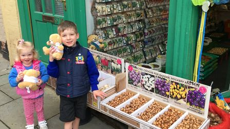 Winners Ben and Sophie outside RE Rolph Garden & Pet Supplies in Royston. Picture: Royston & Bunting
